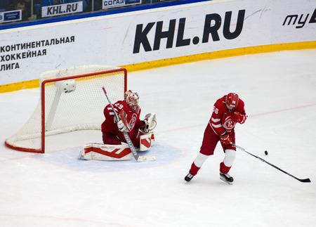 defend: PODOLSK, RUSSIA - NOVEMBER 20, 2016: S. Gimayev (56) defend the gate on hockey game Vityaz vs Lokomotiv on Russia KHL championship on November 20, 2016, in Podolsk, Russia. Vityaz won 2:1