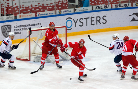 MOSCOW, RUSSIA - NOVEMBER 26, 2016: S. Shmelyov (96) defend the gate on hockey game Spartak vs Slovan on Russian KHL premier hockey league Championship in Luzhniki sport arena, Moscow, Russia. Spartak won 4:2