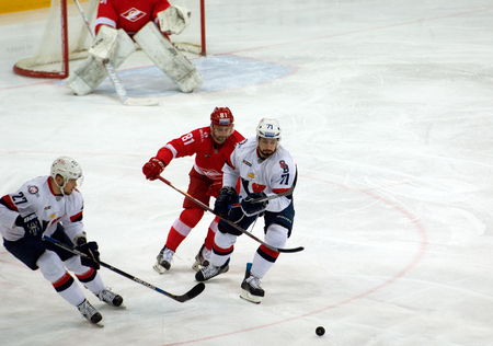 MOSCOW, RUSSIA - NOVEMBER 26, 2016: J. Vaksky (71) attack on hockey game Spartak vs Slovan on Russian KHL premier hockey league Championship in Luzhniki sport arena, Moscow, Russia. Spartak won 4:2