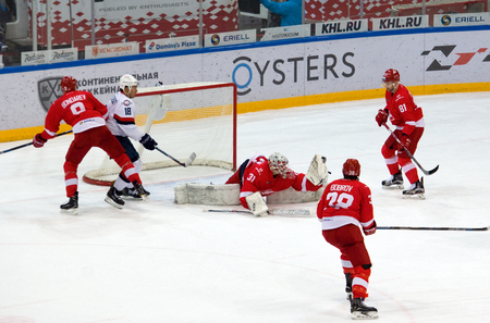 MOSCOW, RUSSIA - NOVEMBER 26, 2016: N. Bespalov (31) catch a puck on hockey game Spartak vs Slovan on Russian KHL premier hockey league Championship in Luzhniki sport arena, Moscow, Russia. Spartak won 4:2
