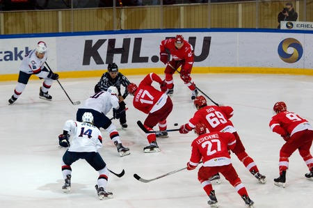 MOSCOW, RUSSIA - NOVEMBER 26, 2016: A. Voronin (17) and J. Taffe (20) on faceoff on hockey game Spartak vs Slovan on Russian KHL premier hockey league Championship in Luzhniki sport arena, Moscow, Russia. Spartak won 4:2 Editorial
