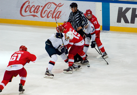MOSCOW, RUSSIA - NOVEMBER 26, 2016: M. Potapov (15) and T. Zigo (27) on faceoff on hockey game Spartak vs Slovan on Russian KHL premier hockey league Championship in Luzhniki sport arena, Moscow, Russia. Spartak won 4:2