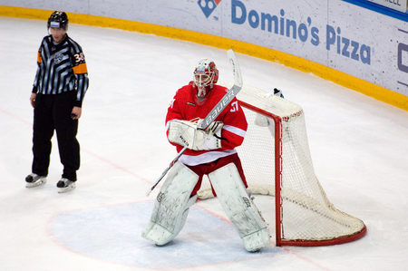 premier: MOSCOW, RUSSIA - NOVEMBER 26, 2016: N. Bespalov (31) catch a puck on hockey game Spartak vs Slovan on Russian KHL premier hockey league Championship in Luzhniki sport arena, Moscow, Russia. Spartak won 4:2