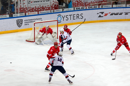 MOSCOW, RUSSIA - NOVEMBER 26, 2016: Unidentified players in action on hockey game Spartak vs Slovan on Russian KHL premier hockey league Championship in Luzhniki sport arena, Moscow, Russia. Spartak won 4:2