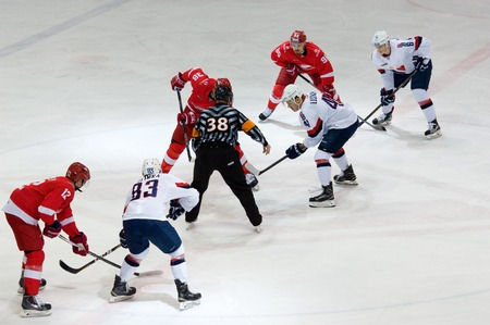 MOSCOW, RUSSIA - NOVEMBER 26, 2016: V. Bobrov (38) and P. Lusnak (41) on faceoff on hockey game Spartak vs Slovan on Russian KHL premier hockey league Championship in Luzhniki sport arena, Moscow, Russia. Spartak won 4:2 Editorial