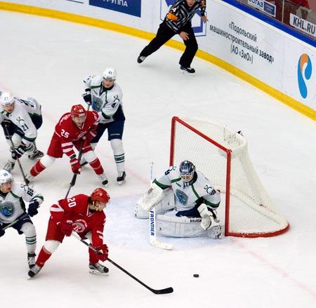 PODOLSK, RUSSIA - DECEMBER 4, 2016: M. Kempe (20) attack on hockey game Vityaz vs Ugra on Russia KHL championship on December 4, 2016, in Podolsk, Russia. Ugra won 3:2 Editorial