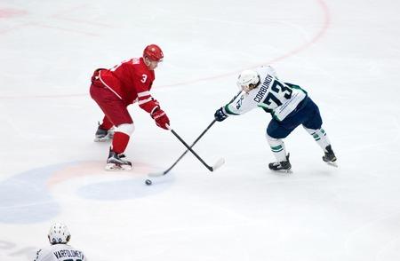 PODOLSK, RUSSIA - DECEMBER 4, 2016: D. Gorbunov (73) vs M. Epishin (3) on hockey game Vityaz vs Ugra on Russia KHL championship on December 4, 2016, in Podolsk, Russia. Ugra won 3:2