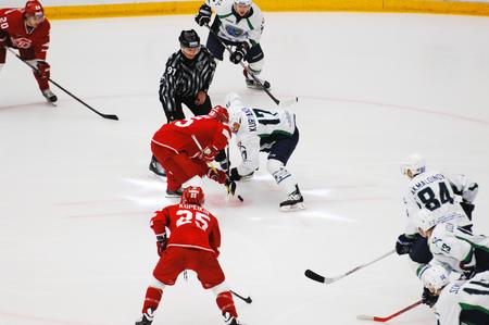 PODOLSK, RUSSIA - DECEMBER 4, 2016: A. Kuryanov (17) and M. Aaltonen (55) on faceoff on hockey game Vityaz vs Ugra on Russia KHL championship on December 4, 2016, in Podolsk, Russia. Ugra won 3:2 Editorial