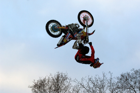 nikolay: MOSCOW, RUSSIA - DECEMBER 10, 2016: FMX rider Nikolay Ivankov jump on bike trampoline on Winter game season opening event on December 10, 2016 Editorial