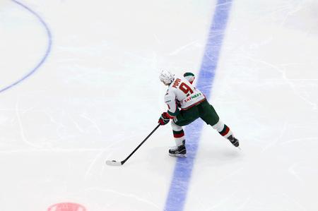 PODOLSK, RUSSIA - JANUARY 14, 2017: A. Popov (9) dribble on hockey game Vityaz vs AKBars on Russia KHL championship on January 14, 2017, in Podolsk, Russia. Vityaz won 3:2