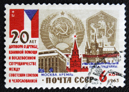 postwar: MOSCOW, RUSSIA - JANUARY 7, 2017: A stamp printed in USSR devoted to 20th anniversary of the Treaty of friendship, mutual assistance and postwar cooperation, circa 1963