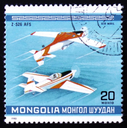 estampilla: MOSCOW, RUSSIA - FEBRUARY 12, 2017: A Stamp printed in Mongolia shows the Z-526 AFS Plane, from the series Editorial