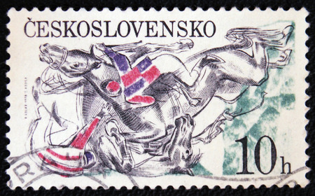 old envelope: MOSCOW, RUSSIA - JANUARY 7, 2017: A stamp printed in the Czechoslovakia, Pardubice Steeplechase, shown Falling horses and jockeys at fence, circa 1978