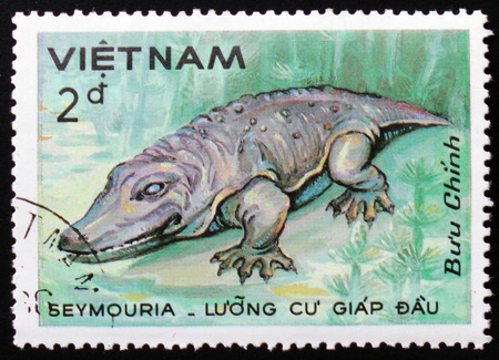 old envelope: MOSCOW, RUSSIA - FEBRUARY 12, 2017: The postal stamp printed in VIETNAM shows Seymouria, series dinosaurs, circa 1984