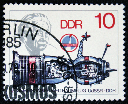 old envelope: MOSCOW, RUSSIA - JANUARY 7, 2017: A post stamp printed in Germany shows spaceship and portrait of scientist Albert Einstein, circa 1979