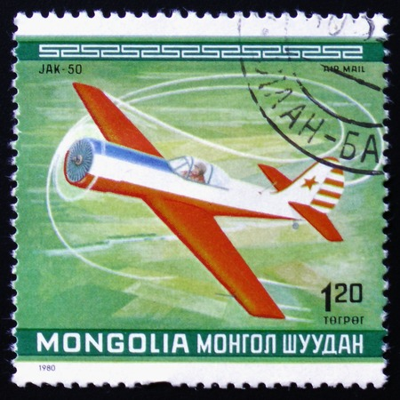 MOSCOW, RUSSIA - FEBRUARY 12, 2017: A Stamp printed in MONGOLIA shows the Jak-50 Plane, from the series Editorial
