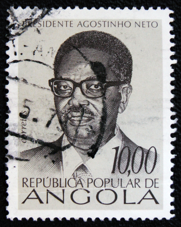 old envelope: MOSCOW, RUSSIA - JANUARY 7, 2017: A stamp printed in Angola shows the President Agostinho Neto, circa 1976