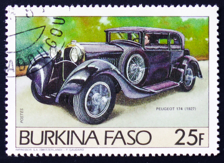 old envelope: MOSCOW, RUSSIA - FEBRUARY 12, 2017: A stamp printed in Burkina Faso shows retro car Peugeot 174, circa 1983