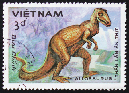 old envelope: MOSCOW, RUSSIA - FEBRUARY 12, 2017: A stamp printed in Vietnam shows prehistoric animal Allosaurus, circa 1984