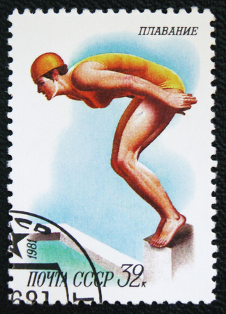 estampilla: MOSCOW, RUSSIA - JANUARY 7, 2017: A stamp printed in the USSR shows a woman jumps into the water, the series