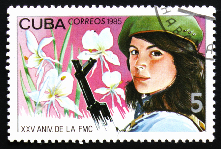 MOSCOW, RUSSIA - FEBRUARY 19, 2017: A stamp printed in Cuba devoted to 25 unniversary of Federation of women of Cuba, circa 1985