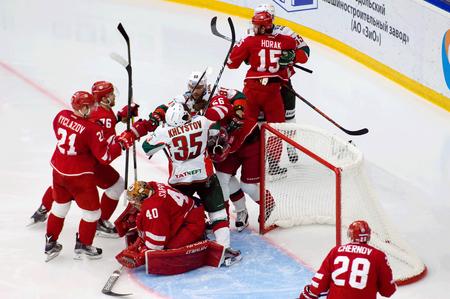 PODOLSK, RUSSIA - JANUARY 14, 2017: S. Gimayev (56) and D. Khlystov (35) fight on hockey game Vityaz vs AKBars on Russia KHL championship on January 14, 2017, in Podolsk, Russia. Vityaz won 3:2