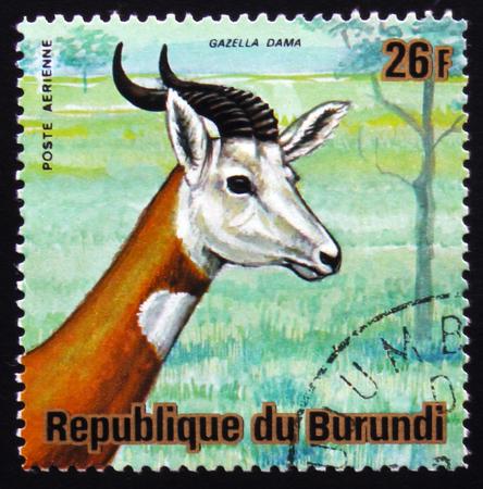 estampilla: MOSCOW, RUSSIA - FEBRUARY 19, 2017: A stamp printed by Burundi shows dama gazelle, addra gazelle, or mhorr gazelle (Nanger dama, formerly Gazella dama), series Animals Burundi, circa 1975 Editorial