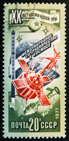 MOSCOW, RUSSIA - APRIL 2, 2017: A post stamp printed in USSR shows space ship and devoted to 20 Space research unniversary and International comunity, circa 1977 Editorial