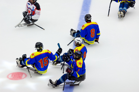 PODOLSK, RUSSIA - JANUARY 14, 2017: Unidentified players of Ladoga (blue) and Zvezda (white)  team of Sledge hockey during game Vityaz vs AKBars on Russia KHL championship on January 14, 2017 Editorial