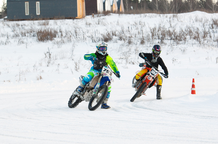 BREKHOVO, MOSCOW REGION, RUSSIA - JANUARY 21, 2017: P. Groznov (753) and K. Shafro (304) during Winter open cup of DOSAAF MX Speedway on January 21, 2017