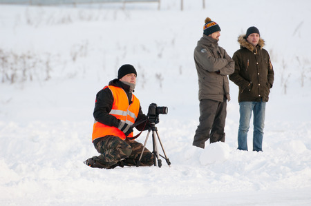 BREKHOVO, MOSCOW REGION, RUSSIA - JANUARY 21, 2017: Unidentified photographer filming during Winter open cup of DOSAAF MX Speedway on January 21, 2017