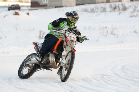BREKHOVO, MOSCOW REGION, RUSSIA - JANUARY 21, 2017: Unidentified rider drive during Winter open cup of DOSAAF MX Speedway on January 21, 2017