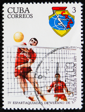 estampilla: MOSCOW, RUSSIA - APRIL 2, 2017: A post stamp printed in Cuba devoted to 4 Spartakiad and shows Volleyball players, circa 1977