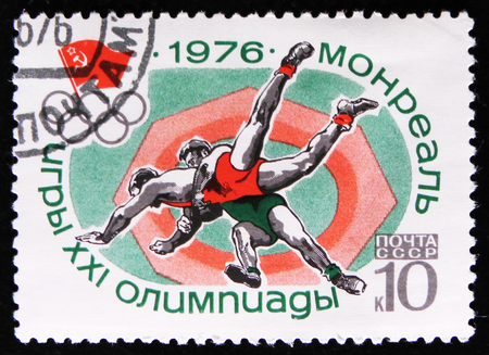 MOSCOW, RUSSIA - APRIL 2, 2017: A post stamp printed in USSR shows Wrestling sport, Olympic games in Montreal, Canada, circa 1976 Editorial