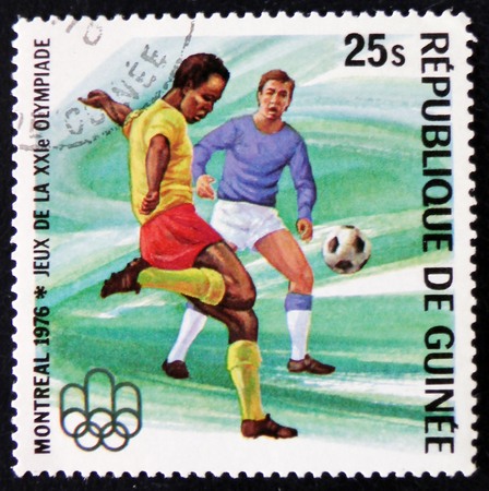 MOSCOW, RUSSIA - APRIL 2, 2017: A post stamp printed in Republic of Guinea shows football players, series Montreal Olympic games, circa 1976 Editorial