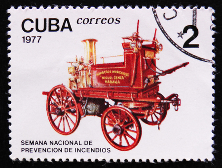 MOSCOW, RUSSIA - APRIL 2, 2017: A post stamp printed in Cuba shows horse-drawn fire engine pump, Accident prevenion auto serie, circa 1977