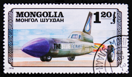 MOSCOW, RUSSIA - APRIL 2, 2017: A post stamp printed in Mongolia shows Blue flame transport airplane, circa 1978