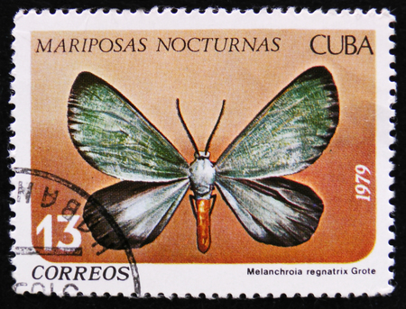 MOSCOW, RUSSIA - APRIL 2, 2017: A post stamp printed in Cuba shows butterfly with the inscription Melanchroia regnatrix, Night moth series, circa 1979 Editorial