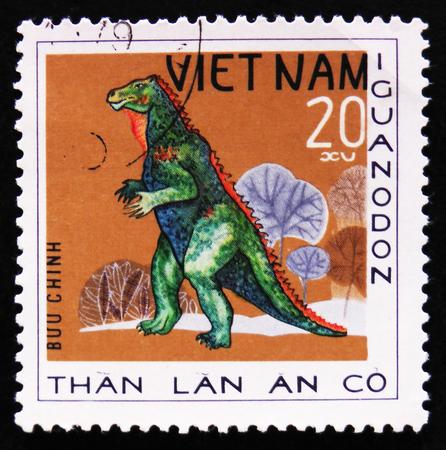 estampilla: MOSCOW, RUSSIA - APRIL 2, 2017: A post stamp printed in Vietnam shows dinosaur Iguanodon, series Prehistoric animals, circa 1978