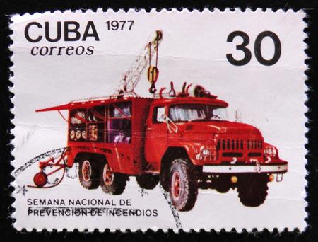 MOSCOW, RUSSIA - APRIL 2, 2017: A post stamp printed in Cuba shows Crane truck, Accident prevenion auto serie, circa 1977