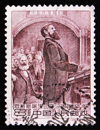 MOSCOW, RUSSIA - APRIL 2, 2017: A post stamp printed in China Karl Marx and Friedrich Engels, circa 1960