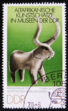 MOSCOW, RUSSIA - APRIL 2, 2017: A post stamp printed in DDR (germany) shows a stone figure of bull, the series Editorial
