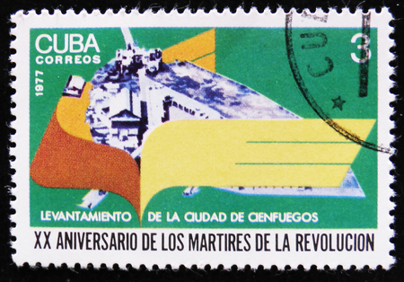 MOSCOW, RUSSIA - APRIL 2, 2017: A post stamp printed in Cuba devoted to the 20 anniversary of adjournment city of Cienfuegos, circa 1977