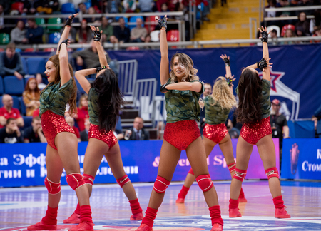 MOSCOW, RUSSIA - JANUARY 27, 2017: Cheerleaders of CSKA team  dance on basketball game CSKA vs Anadolu Efes on Regular championship of Euroleague on January 27, 2017, in Moscow, Russia. CSKA won 80:77