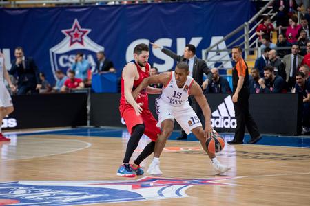 MOSCOW, RUSSIA - JANUARY 27, 2017: J. Granger (15) vs N. Kurbanov (41) on basketball game CSKA vs Anadolu Efes on Regular championship of Euroleague on January 27, 2017, in Moscow, Russia. CSKA won 80:77