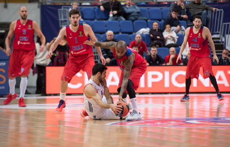 MOSCOW, RUSSIA - JANUARY 27, 2017: D. Balbay (4) fall down on basketball game CSKA vs Anadolu Efes on Regular championship of Euroleague on January 27, 2017, in Moscow, Russia. CSKA won 80:77