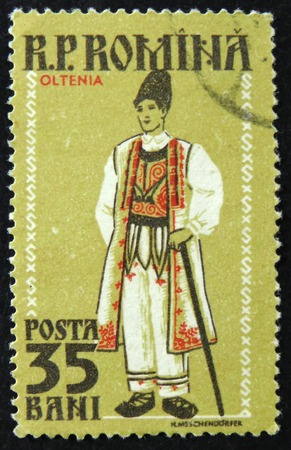 MOSCOW, RUSSIA - APRIL 2, 2017: A post stamp printed in Romania shows Regional Costume, Oltenia, circa 1958 Editorial