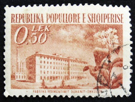 MOSCOW, RUSSIA - APRIL 2, 2017: A post stamp printed in Albania shows Facrory of fermentation tobacco, circa 1964 Editorial