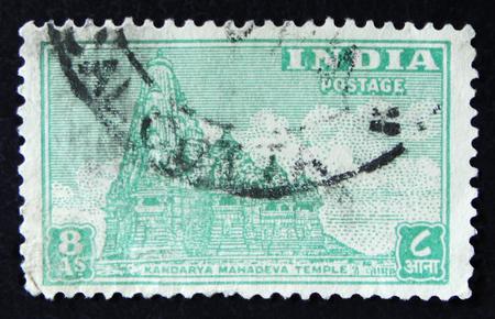 MOSCOW, RUSSIA - APRIL 2, 2017: A post stamp printed in India shows Kandarya Mahadeva Temple, circa 1949 Editorial