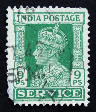 MOSCOW, RUSSIA - APRIL 2, 2017: A post stamp printed in India shows King George VI, circa 1942 Editorial